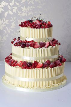 Chocolate Cigarello Berry Fountain - http://www.lepapillonpatisserie.com/wedding-cakes/chocolate-cigarello-berry-fountain/#