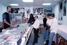 Krist Novoselic, Dave Grohl and Kurt Cobain visiting a record store in 1992