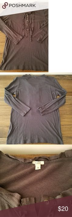 J. Crew ruffle shirt This super soft charcoal gray shirt features buttons and a ruffle detail on the chest and neck. 3/4 length sleeves. Women's size medium. Perfect under your favorite cardigan! J. Crew Tops Tees - Long Sleeve
