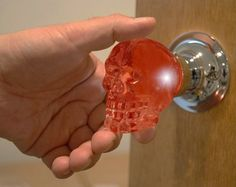 """""""Skull door knobs: creepy or the best thing ever?"""" -- And they light up when you touch them! Best thing ever!"""