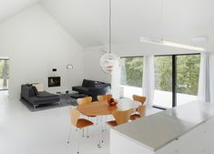 A living and dining room occupies the central section of this Finnish house.