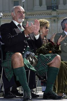 Wearing a kilt, Actor Sean Connery applauds during a  William Wallace Awards Ceremony on Capitol Hill Thursday, April 5, 2001.  Connery's wife, Lady Connery, is at his side. (AP Photo/Dennis Cook)