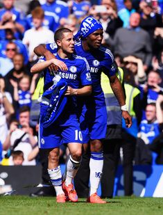 Eden Hazard Photos - Eden Hazard (L) and Didier Drogba of Chelsea celebrate winning the Premier League title after the Barclays Premier League match between Chelsea and Crystal Palace at Stamford Bridge on May 3, 2015 in London, England. Chelsea became champions with a 1-0 victory. - Chelsea v Crystal Palace - Premier League