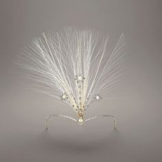 Chaumet aigrette, circa 1910, inspired by the V-shaped hairstyle of Mary, Queen of Scots, and featuring pins reminiscent of the swaying wildflowers found in the magnificent landscape north of the border