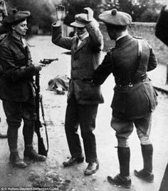 A suspected member of the Irish nationalist party Sinn Fein is searched at gunpoint by temporary constables of the British Black and Tans, during the Irish War of Independence, Ireland, November Get premium, high resolution news photos at Getty Images Ireland 1916, Irish Independence, Irish Republican Army, Rebel, Images Of Ireland, Michael Collins, Irish Celtic, Irish Eyes, British History