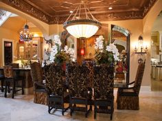 Donna utilizes artistic ironwork, custom dining chairs and stylized filigree to give the space a more ornate and welcoming character.