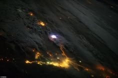 Snapped by an astronaut aboard the International Space Station on December 12, 2013, the image shows a white flash of lightning amidst the yellow city lights of Kuwait and Saudi Arabia. Researchers are now using instruments aboard the space station to try and find out more about lightning and its effects.