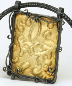 Natasha Wozniak's Brocade Pendant in 18kt gold and oxidized silver