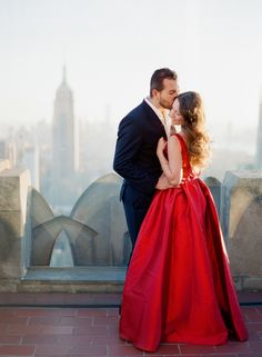 Photography: You Look Lovely Photography - youlooklovelyphotography.com   Read More on SMP: http://www.stylemepretty.com/2016/02/14/engagement-session-at-the-top-of-the-rock-in-new-york-city/