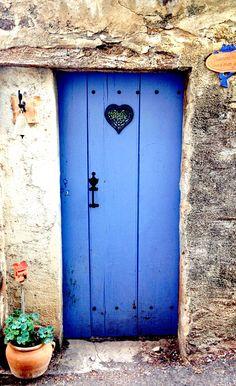 Sahorre, Pyrénées-Orientales, France, simple blue wooden door with sweet heart