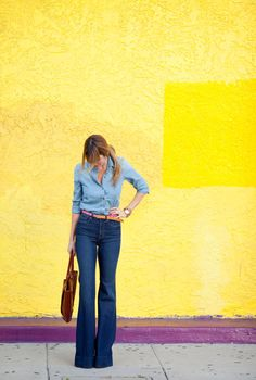 denim on denim, high waist bell-bottoms, bright belt, hair, bold lips, yellow wall... what could be better?!