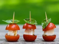 Mini Caprese Bites:  1 pt. cherry tomatoes, halved  1/2 pound fresh mozzarella, cut into cubes  1/4 cup extra virgin olive oil  2 tablespoons balsamic vinegar  1/4 teaspoon kosher salt  1/4 teaspoon pepper  Fresh basil leaves  Kosher salt and pepper to taste