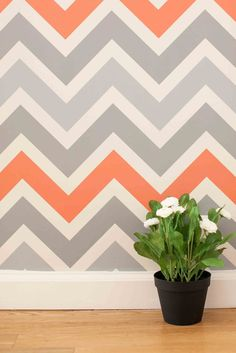 Chevron 2.0 – Chasing Paper Grey Chevron with coral stripes. Would be $360 for the wall.
