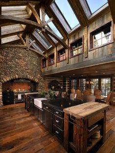 Natural lighting in a very spacious, rustic-looking kitchen. Kitchen Design - page 11