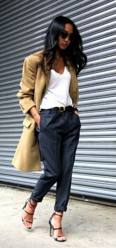 Tee shirt, Trousers and a Camel coat.