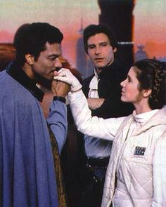 Look at the way Han is looking at Leia, he's looking at her reaction to see if she is falling for Lando's moves.