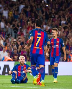 Lionel Messi (L) of FC Barcelona celebrates with his teammates Arda Turan (C) and Denis Suarez (R) after scoring his team's third goal during the Spanish Super Cup Final second leg match between FC Barcelona and Sevilla FC at Camp Nou on August 17, 2016 in Barcelona, Catalonia.