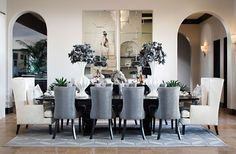 Contemporary Dining Room with Jacqueline hostess wing back occasional dining arm chair, Wall sconce, travertine tile floors