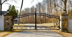 A wrought iron driveway gate for a wide driveway. Installed by Tri State Gate, Bedford Hills, NY. Wrought Iron Driveway Gates, Iron Gates, Bedford Hills, Entry Gates, Deck, New York, Outdoor Decor, Modern