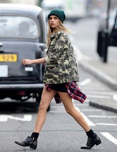 No pants, just camo. Cara Delevingne looking effortlessly stylish as per usual.
