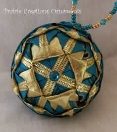 Folded Ribbon Quilted Christmas Ball Ornament Sparkling Gold and Peacock Original Design. $23.00, via Etsy.