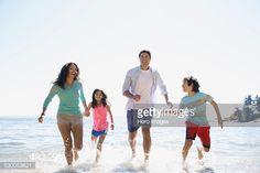 Family splashing in ocean
