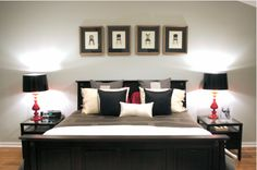 black bedroom with red and white accents