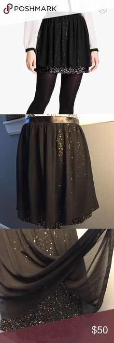 """NTW DKNY layered sequin skirt DKNY NWT layered sequin skirt. PERFECT for holiday Christmas and New Years party. I can't remember if u got this at Sacks or Nordstrom. Size is 10. Waist measures 31, length is 18. Has hidden side zipper. This item states it's machine washable on cold/gentle cycle. Original price tag of $119 is still attached. Has a 1"""" faux leather waistband. 🎀Suggested User🎀 DKNYC Skirts Mini"""