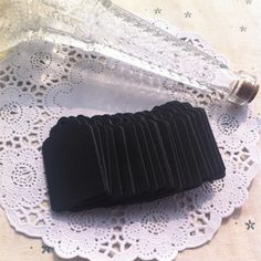 A personal favourite from my Etsy shop https://www.etsy.com/listing/204311029/small-black-kraft-tags-in-scallop-shape