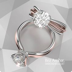 Solitaire engagement ring for a round diamond center with Bouquet style split shank in 18k white and rose gold. Click to see more beautiful split shank ....