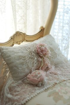 super-sweet white pillow, very embellished, pink roses and ribbon and needlework, shabby chic, vintage, cottage bed