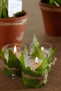 Wrap a votive with silk/fake leaves & tie with twine. Could use battery operated votives.
