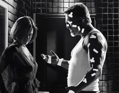 Mickey Rourke and Carla Gugino in Sin City (2005) #movie #frankmiller #robertrodriguez