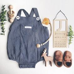 Loving this adorable flatlay from @ simmii featuring our woven pinstripe bodysuit  #pumpkinpatchkids #babyfashion #flatlay