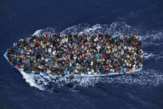 Massimo Sestini - 2015 Refugees crowd on board a boat some 25 kilometers from the Libyan coast, prior to being rescued by an Italian naval frigate working as part of Operation Mare Nostrum (OMN). The search-and-rescue operation was put in place by the Italian government, in response to the drowning of hundreds of migrants off the island of Lampedusa at the end of 2013. The numbers of people risking their lives to cross the Mediterranean Sea rose sharply in 2014, as a result of conflicts.