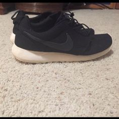 Mens nike roshe runs They are black and white and they are in okay condition. Notice they do have minor creases on the bottom part of the shoe. Nike Shoes Athletic Shoes