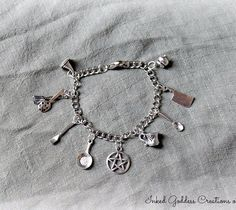 Made from stainless steel and pewter, this Kitchen Witch Cooking Charm Bracelet is a cute way to show your kitchen witchy ways off to the world. This bracelet includes (from left to right in the pictu