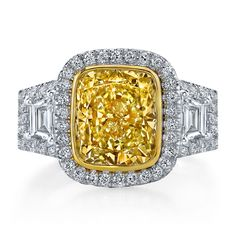 Radiant cut diamond engagement ring. Stunning 3.29 carat fancy yellow radiant cut diamond surrounded by diamond halo and flanked by shield diamonds.  Call 216-464-6767 for more information.
