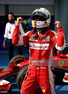 Sebastian Vettel of Germany and Ferrari celebrates in Parc Ferme after winning the Malaysia Formula One Grand Prix at Sepang Circuit on March 29, 2015 in Kuala Lumpur, Malaysia.