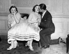 Margaret Gibbs gets a kiss from her betrothed, while her conjoined sister Mary looks on awkwardly, 1940s