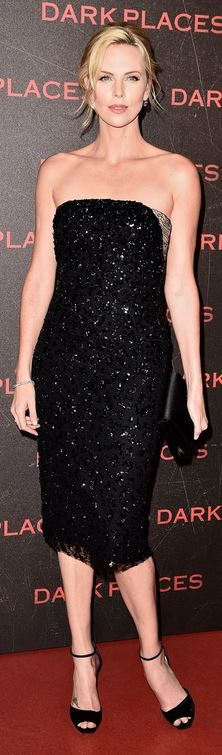 Who made  Charlize Theron's strapless black dress and clutch handbag?