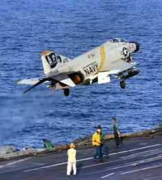 "A Navy F-4J Phantom from VF-84 ""Jolly Rogers"" Fighter Squadron takes to the sky of the carrier deck."