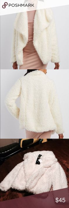 IVORY FAUX FUR JACKET! BRAND NEW! SUPER SOFT AND PLUSH FEEL VERY PERFECT TO WEAR WITH ANY COLOR YOU CHOOSE. Online only! With its oversize collar and shaggy faux fur, this oversize jacket is one major statement maker! Slant pockets at the waist add a little storage to the open silhouette. MEJANE Jackets & Coats