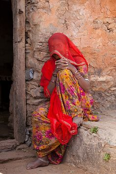 veiled hindu woman in village, near udaipur rajasthan, india