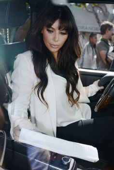 Kim Kardashian gets a new fringe cut, shows of her bangs on ...