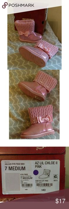 NIB Girl's UGG-style Boots Glitter Pink Bow Sz. 7 Girls toddler size 7 pink UGG-style boots with knit/sweater cuff and satin bow. Boots are glittery and adorable! New in box, never used.  +Makes a great Christmas gift! Bundle with my other men's/women's items or kids/baby clothes :-) Please ask any questions before buying. Smoke & pet free home. Thanks for shopping this WAHM's Suggested User closet! No lowballing please! Arizona Jean Company Shoes Boots