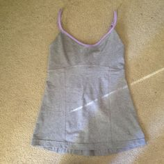 Lululemon tank top Grey with lavender trim. In perfect condition lululemon athletica Tops Tank Tops