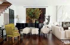 Sheep sculptures by François-Xavier Lalanne flock in front of a Yamaha grand piano in a Beverly Hills living room.