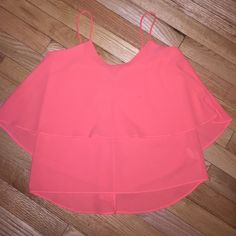 Coral colored paper crane tank top! Cute paper crane tank top! Great summery color and flowy as well! Size XS! There is a small grease stain on the front of the top shown in the 2nd photo! Paper Crane Tops Tank Tops