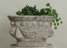 A regency style round jardiniere with fruit swags and ribbon knots. Just right proportions for entry ways, terraces, gardens. Hand made using cast limestone which ages beautifully. Imported from England. Please note: The version of the Ribbon Swag Jardiniere shown here has developed a nice weathered patina. The original color is Portland limestone. If you would like to fast forward nature, please ask us about our hand staining weathered finish. To learn about dry cast limestone and how it's diff Garden Ornaments For Sale, Entry Ways, Cast Stone, Terraces, Regency, New England, Portland, This Is Us, Knots